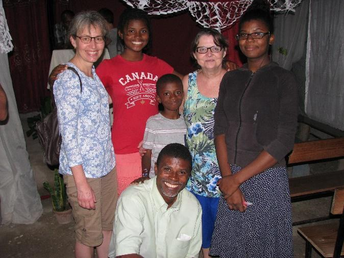 Pastor Belade and his children with Donna and Bonnie.